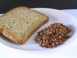 Whole wheat bread is made from whole wheat pounded into flour. This process changes the grain to cause a higher bump in sugar level than eating the cooked whole grain.
